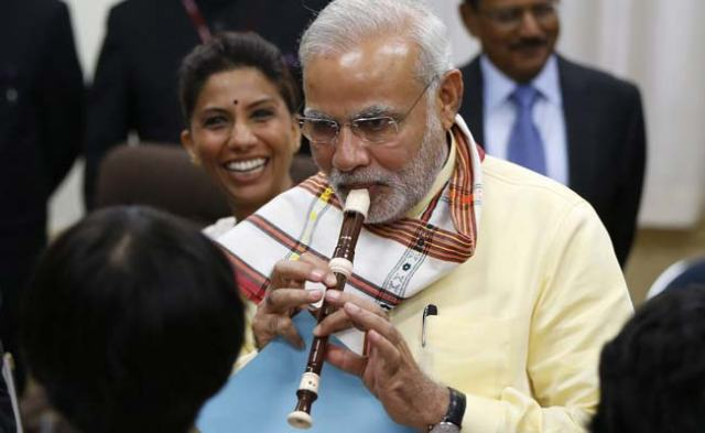 modi plays flute in japan