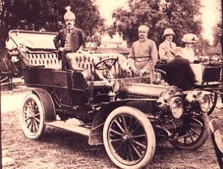 Nizam VII of Hyderabad poses in a car, one of the large fleet owned by him