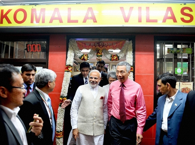 Singapore: Prime Minister Narendra Modi with  his Singaporean counterpart Lee Hsien Loong leaves , at Komala Vilas Restaurant, Little India, Singapore on Monday. PTI Photo(PTI11_23_2015_000309B)