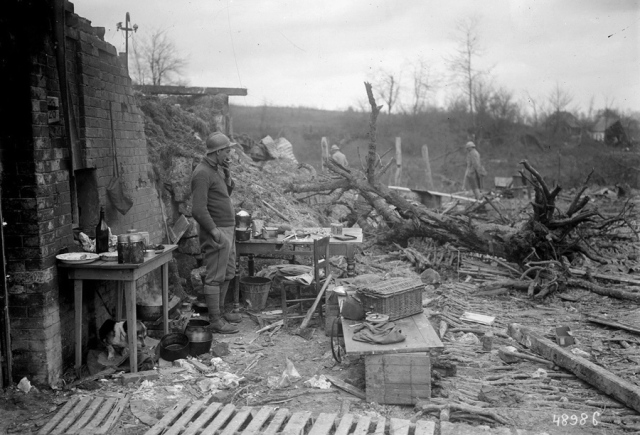 france-soldiers-and-a-dog-outside-a-ruined-house-in-1917